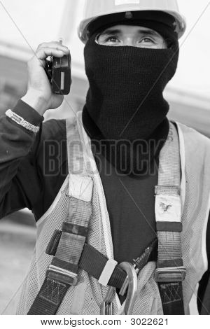Construction Worker Using A Handheld Transceiver