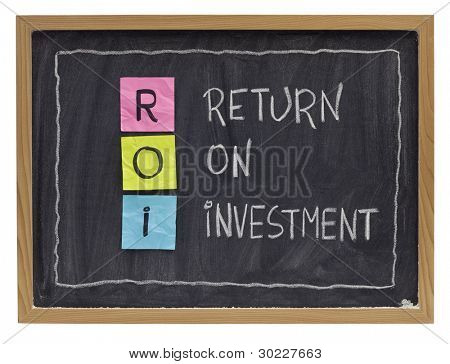 ROI - return on investment acronym explained with color sticky notes and white chalk handwriting on blackboard