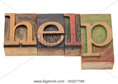 help word in vintage wood letterpress printing blocks, stained by color inks, isolated on white