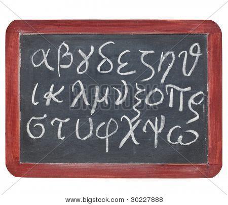 Greek alphabet from alpha to omega - white chalk handwriting on a small slate blackboard