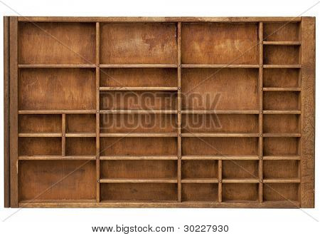 vintage wood  printer  (typesetter) drawer with numerous dividers, isolated on white