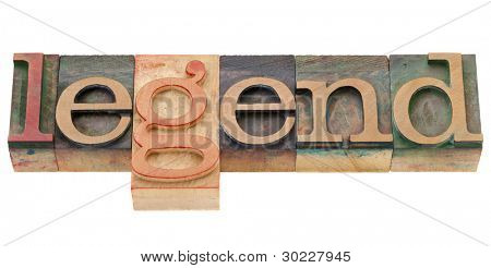 vintage wood printing blocks spelling word legend, isolated on white