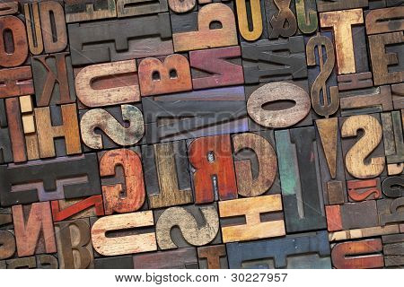 antique letterpress printing blocks with color ink patina, random collection of different size and style