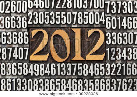2012 number in vintage wood letterpress printing  blocks surrounded by random metal numbers