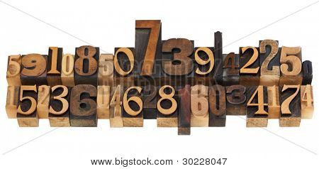 numerical concept - two rows of random numbers - isolated vintage wood letterpress printing blocks
