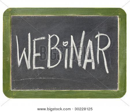 webinar word in white chalk handwriting on a vintage slate blackboard, isolated on white