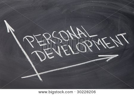 personal development concept - white chalk drawing on a blackboard