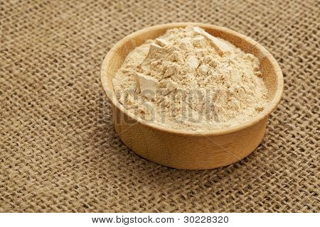 maca root powder (nutrition supplement - superfood from Andies) in a wood bowl