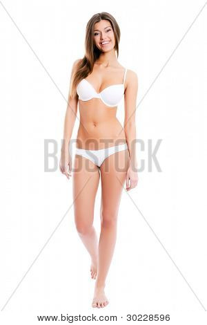 Full length portrait of a stunning young woman posing in lingerie over white background