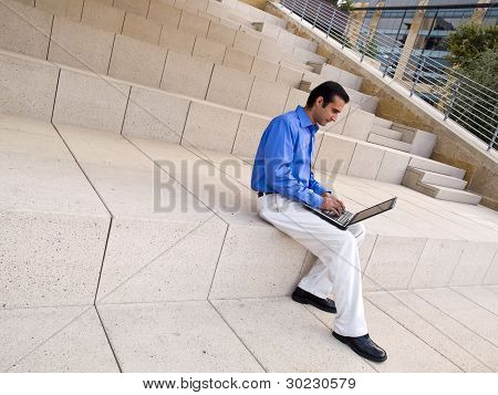 Hispanic Businessman With Laptop