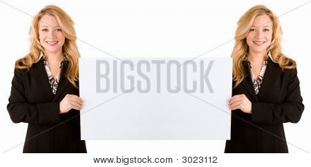 Mirrored Effect Of Woman Holding A Large Blank Card