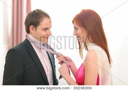 Red Hair Young Woman Helping Tie Necktie