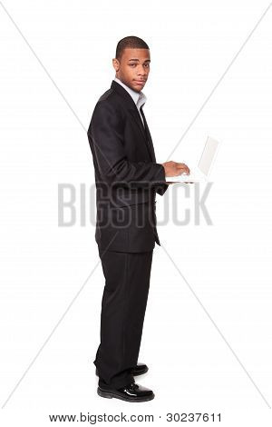 African American Businessman Standing While Using Notebook Computer