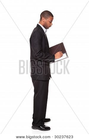 African American Businessman Isolated On White Writing Notepad