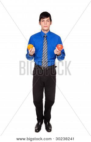 Caucasian Businessman Comparing Apple To Orange
