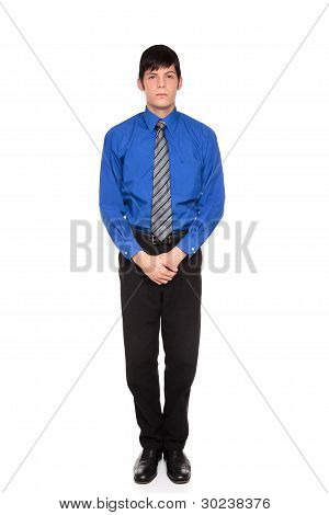 Businessman Standing With Hands Clasped In Front Of Him