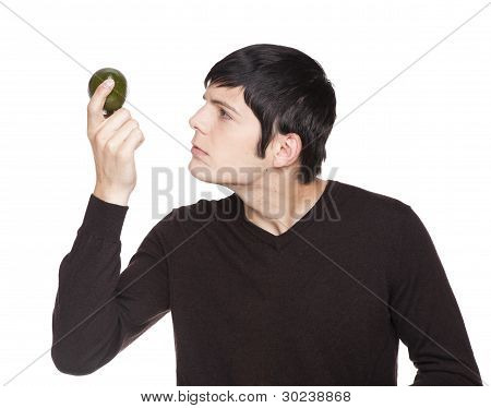 Caucasian Man Examining A Lime