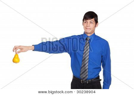 Caucasian Businessman Holding Pear Away With Upset Look