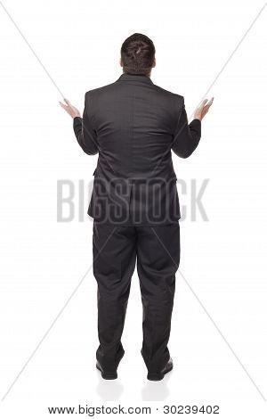 Rear View Upset Caucasian Businessman Raising Arms In Disbelief