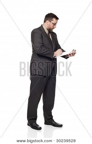 Caucasian Businessman Filling Out Job Application On Clipboard Side View
