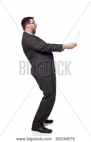 Businessman Holding Laptop Arms Length Shocked Expression