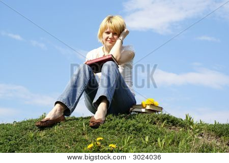 Female Student Outdoor On Green Grass