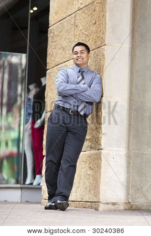Hispanic Businessman - Leaning On Stone Wall