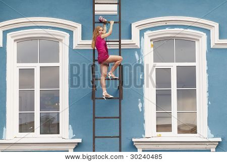 Young woman on stair
