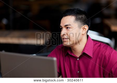 Hispanic Businessman - Telecommuting From Internet Cafe