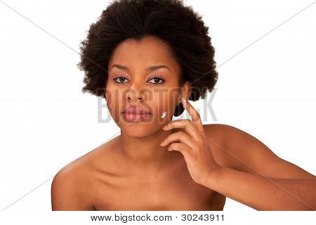 Girl Putting Face Cream