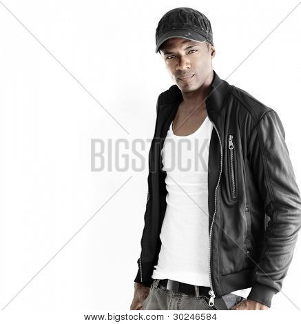 Portrait of a good looking young male model in trendy clothes against neutral white background with copyspace