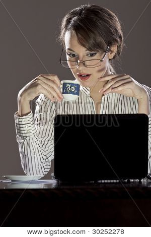 Young excited lady in front of her laptop