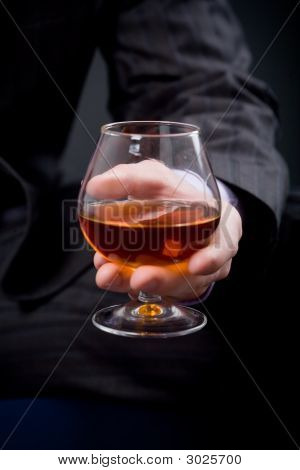 Hand With Glass Of Cognac