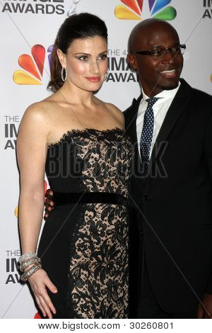 LOS ANGELES - FEB 17:  Idina Menzel; Taye Diggs arrives at the 43rd NAACP Image Awards at the Shrine Auditorium on February 17, 2012 in Los Angeles, CA.