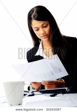 businesswoman entrepreneur  reading sales statistics while sitting at her desk isolated on white