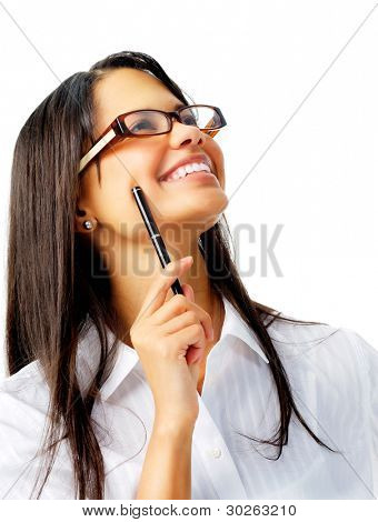 Happy latino woman holding a pen and looking up with glasses, isolated on white