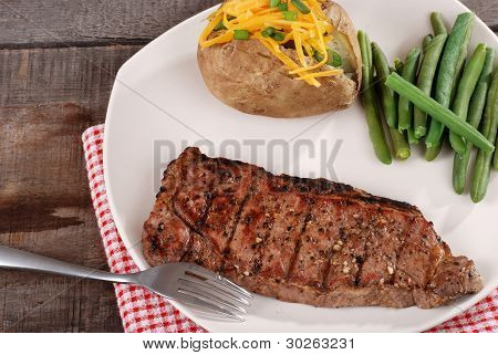 Barbecue strip loin steak with vegetables