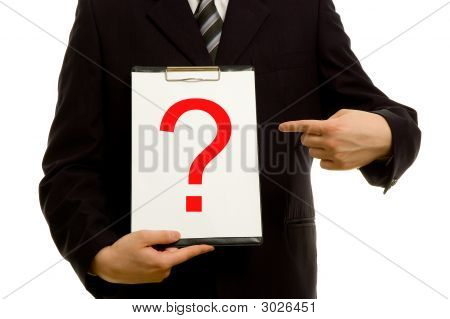 Question Mark On Clipboard In The Hand Of A Businessman