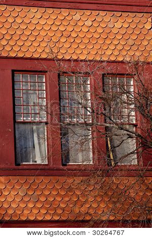 Windows and shingles of the roof of a house in the north eastern part of the United States.