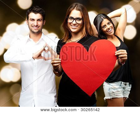 young friends changing channel over abstract lights background