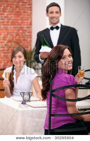 Waiter serving customers