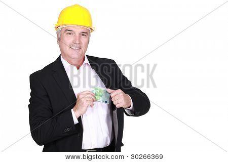 Architect holding cash