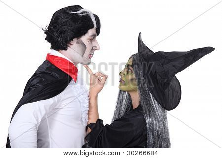 Couple dressed as witch and vampire