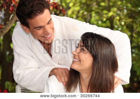 A couple in their bathrobes