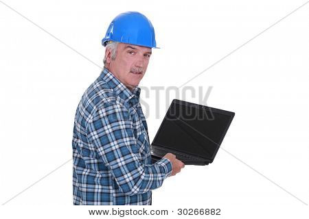 senior craftsman holding a laptop