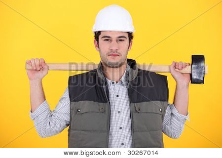 Workman holding a mallet