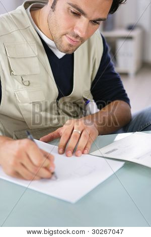 Man writing on a piece of paper