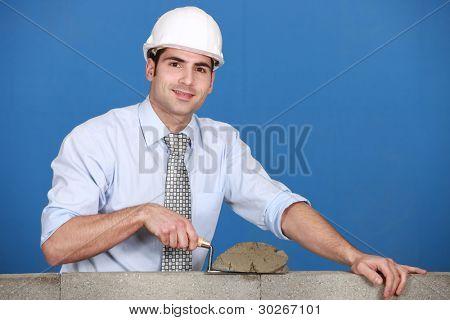 Architect laying a block wall
