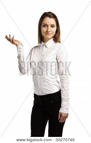 Attractive Business Woman Displaying An Imaginary Product On White