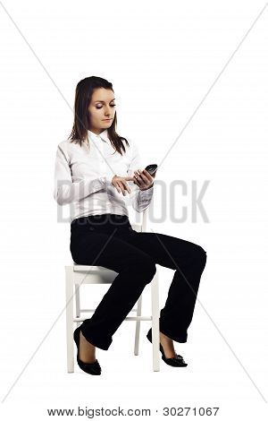 Attractive Business Woman Replying To An Email On Her Smart Phone